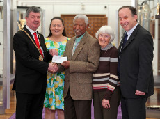 archie sibeko, joyce leason with Newcastle City council receiving  donation